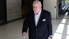 Senator Mike Duffy arrives at Ottawa airport Sunday, returning from a trip to his home in Prince Edward Island. (Dave Chan / CTV News)