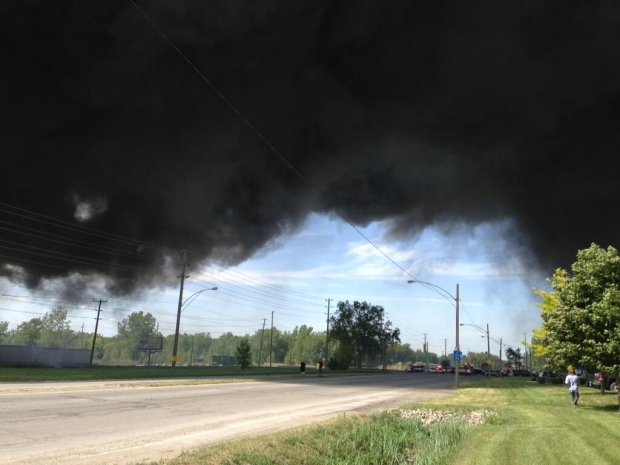 Thick, black smoke billows from a fire in the 700 block of Sprucewood Avenue in Windsor, Ont., on Tuesday, May 21, 2013. (Sacha Long / CTV Windsor)