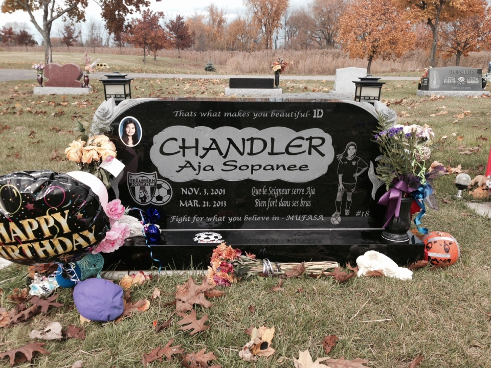 Mementos cover the grave of choking game victim, Aja Chandler in Belle River.  (Sacha Long/ CTV Windsor)