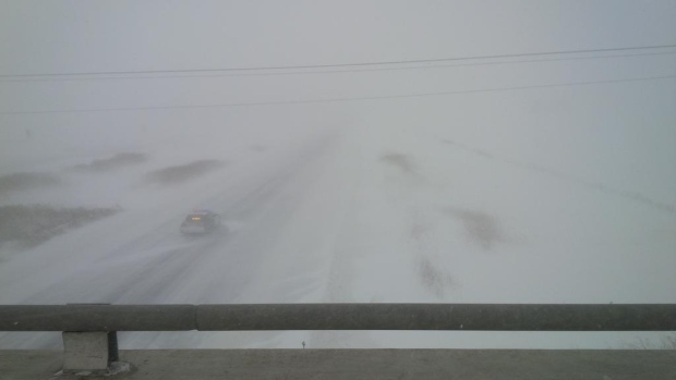 OPP Tweeted this photo of zero visibility on Highway 402 looking westbound from the Centre Road overpass near Strathroy, Ont. on Thursday, Feb. 12, 2015. (@OPP_WR / Twitter)