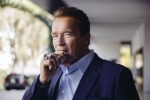 In this Sunday, March 22, 2015 photo, Arnold Schwarzenegger smokes a cigar during press day for 'Terminator: Genisys' at The London Hotel in Los Angeles. (Casey Curry / Invision / AP)