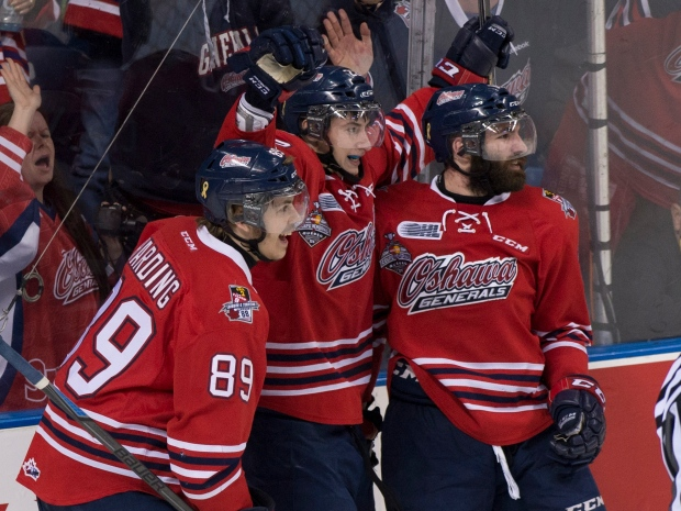 Oshawa Generals forward Anthony Cirelli, centre, is joined by teammates Sam Harding, left, and Bradley Latour, right, after he scored his team's first goal against Kelowna Rockets during second period action at the Memorial Cup final in Quebec City on Sunday, May 31, 2015. (Jacques Boissinot /The Canadian Press)