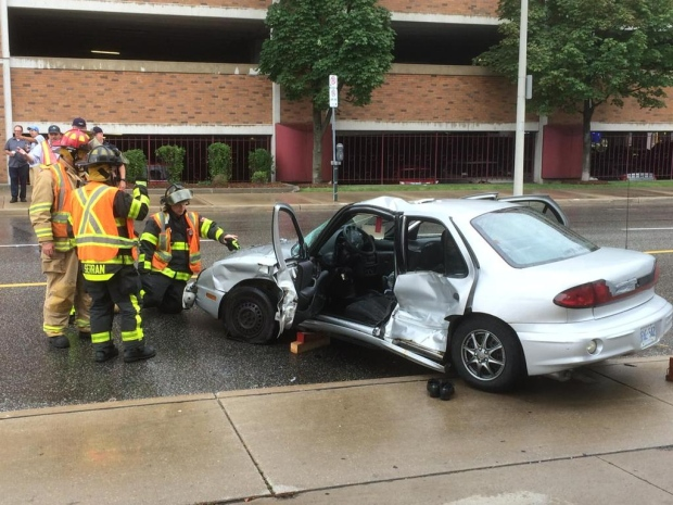 Police are investigating after a serious crash at Erie and Goyeau streets involving a car and a transit bus in Windsor, Ont. on Monday, Aug. 10, 2015. (Dan Appleby / CTV Windsor)