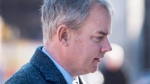 Dennis Oland heads arrives at the Law Courts as his murder trial continues in Saint John, N.B. on Tuesday, Nov. 10, 2015. Oland is charged with second degree murder in the death of his father, Richard Oland, who was found dead in his Saint John office on July 7, 2011. THE CANADIAN PRESS/Andrew Vaughan
