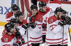 Dejected Canadian players after losing to Finland at the 2016 IIHF World Junior Ice Hockey Championships quarterfinal match between Finland and Canada in Helsinki, Finland, on Saturday Jan. 2, 2016. (Markku Ulander / Lehtikuva via AP)