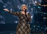 In this Nov. 17, 2015 image released by NBC, Adele performs at Radio City Music Hall in New York. (Virginia Sherwood/NBC via AP)