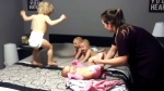 The Cambridge, Ont., parents of 8-month-old triplets and a toddler recently posted a video online of a nightly ritual in their household – getting their four kids ready for bed.