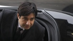 Former CBC radio host Jian Ghomeshi walks past protesters as he arrives at a Toronto court for day six of his trial on Tuesday, Feb. 9, 2016. (Chris Young / THE CANADIAN PRESS)