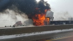 A truck caught fire following a collision on Highway 401 west of Woodstock on Wednesday, Feb. 10, 2016. (Sabrina Dell)