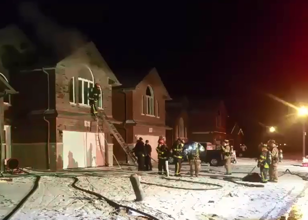 Firefighters battle a basement fire in a home on McRobbie Rd in Windsor, Ont, on Friday, February 12, 2016. (Arms Bumanlag / CTV Windsor)