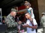 An army soldier explain how to combat the Aedes aegypti mosquito that spreads the Zika virus, at the Central station, in Rio de Janeiro, Brazil, Saturday, Feb. 13, 2016. (AP/Silvia Izquierdo)