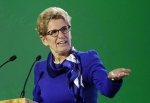 Ontario Premier Kathleen Wynne delivers her speech during a signing ceremony at the COP21, the United Nations Climate Change Conference, Monday, Dec. 7, 2015 in Le Bourget, north of Paris. (Christophe Ena / The Canadian Press)