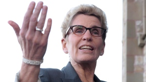 In this file photo, Ontario Premier Kathleen Wynne speaks to reporters as she arrives at the First Ministers meeting in Ottawa on Monday, Nov. 23, 2015. Wynne begins a week-long trade mission to the Middle East Sunday. (Sean Kilpatrick/ The Canadian Press)