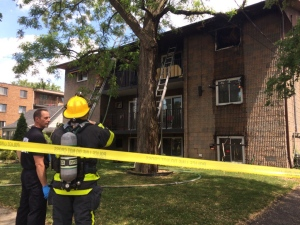 Windsor firefighters were called to an apartment fire on Sandwich Street in Windsor, Ont., on Monday, May 30, 2016. (Michelle Malucke / CTV Windsor)