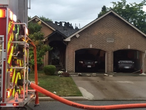 Damage is extensive following a house fire in East Windsor on Tuesday, June 28, 2016. (Alana Hadadean / CTV Windsor)