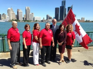 Mayor Drew Dilkens stands with supporters of the Great Canadian Flag Project in Windsor, Ont., on Wednesday, June 29, 2016. (Angelo Aversa / CTV Windsor)