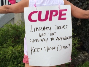 Striking library worker shows off her sign on July 1, 2016. (AM800/Rob Hindi)