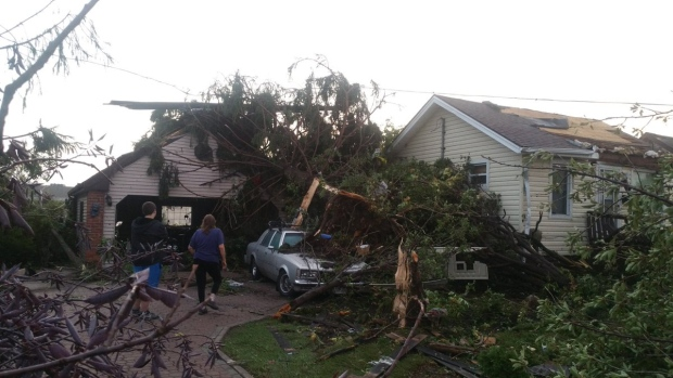 Residents survey the damage on Riberdy Rd. following a probable Tornado in LaSalle and Windsor on Thursday, August 25, 2016. (Arms Bumanlag / CTV Windsor)