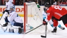 Team Canada's Sidney Crosby, right, scores on Team Europe goalie Jaroslav Halak in Toronto on Sept. 21, 2016. (Frank Gunn / THE CANADIAN PRESS)