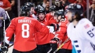 Team Canada's Patrice Bergeron (37) celebrates his goal against Team Europe with teammates Brad Marchand (63), Sidney Crosby (87), Drew Doughty (8) and Jay Bouwmeester (4) as Europe's Mats Zuccarello (63) skates by during third period World Cup of Hockey finals action in Toronto on Tuesday, September 27, 2016. (THE CANADIAN PRESS/Nathan Denette)