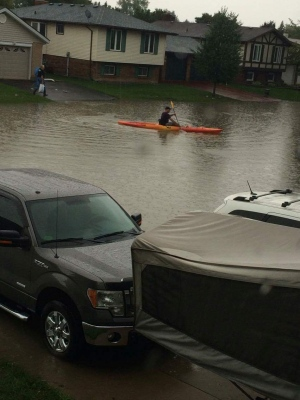 A resident in the town of Tecumseh takes the opportunity to go for a Kayak down the street. (Arms Bumanlag / CTV Windsor)