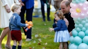 Britain's Prince William and Princess Charlotte look on as Prince George plays with a bubble gun at a children's party at Government House in Victoria, British Columbia, Thursday, Sept. 29, 2016. (Chris Wattie/The Canadian Press via AP, Pool)