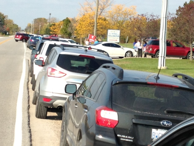 Long line of teachers waiting to get into St.Thomas of Villanova as picket line continues and student leave for home in LaSalle, Ont., on Tues., Oct. 18, 2016. (chris Campbell / CTV Windsor)
