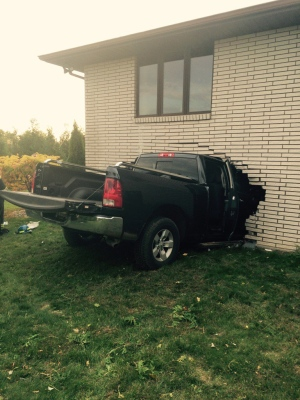 A black Dodge pickup crashed into the Mexican Consulate in Leamington on Sunday, October 23, 2016. (Leamington Fire)