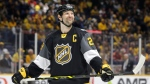 Pacific Division forward John Scott looks into the stands during the NHL hockey All-Star championship game against the Atlantic Division Sunday, Jan. 31, 2016, in Nashville, Tenn. (Mark Humphrey/AP Photo)