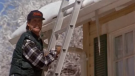 "Clark Griswold, played by Chevy Chase, hangs holiday lights in this scene from the 1989 film ""National Lampoon's Christmas Vacation."" (Warner Bros.)"