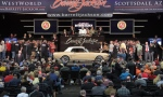 A first-generation Mustang convertible crosses the block at Barrett-Jackson's 2017 auction in Arizona