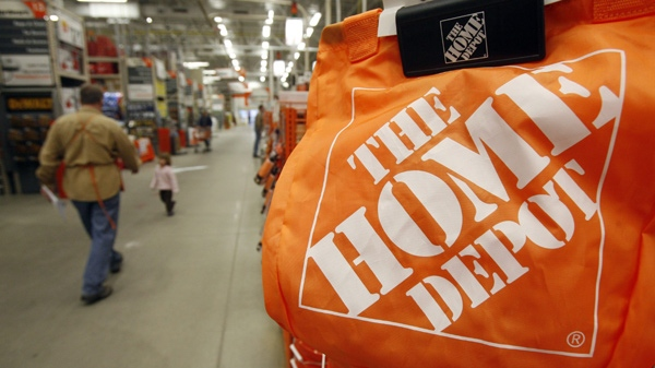Shoppers walk through the aisles at the Home Depot store in Williston, Vt., Monday, Feb. 22, 2010. (AP Photo / Toby Talbot)